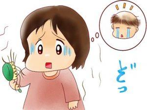 抜け毛で涙を流す女性
